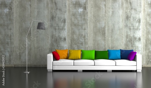 Wohndesign - Sofa mit bunten Kissen vor Betonwand