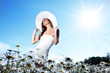 girl in dress on the daisy flowers field