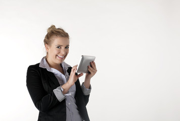A young business woman is pleased with the Tablet PC
