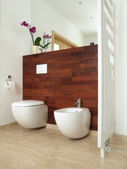 Luxurious bathroom with exotic wooden wall