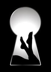 Silhouette of woman legs seen through a key hole