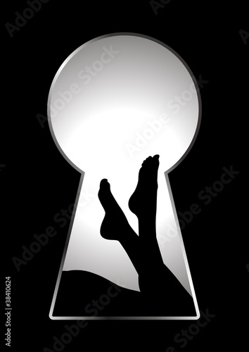 Silhouette of woman legs seen through a key hole