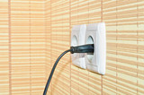 Power plug into the socket on the wall