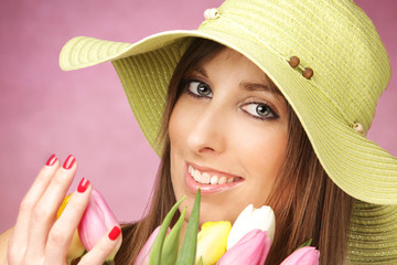 Beautiful woman with tulips