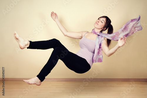 Young woman levitating