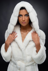 Beautiful woman in white fur coat