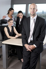 smart businessman along with business colleagues