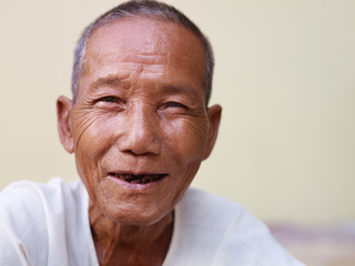 Portrait of happy old asian man smiling at camera