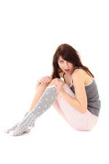 amazed woman in pajamas sitting