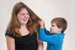 Boy Pulling Sister's Hair