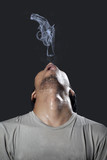Man with pistol made of smoke