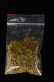 marihuana in package on black background