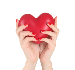 Red heart in woman's hands isolated on white