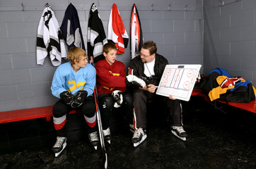 Coach Gives Lessons To Hockey Players in Dressing Room