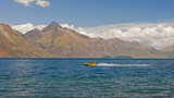 Fast boats sail on the lake near Queenstown