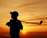 male golfer sunset
