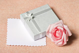 Gift box with blank card on peach background