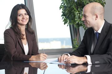 Lächeln beim Businessmeeting