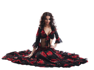 young woman sit in gypsy black and red costume