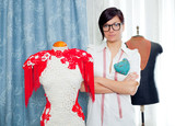 Dressmaker with mannequin working at home poster