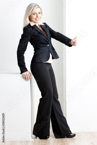 standing young businesswoman