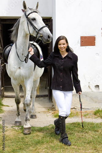 equestrian with horse at stable
