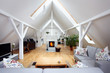 Leinwanddruck Bild - large, attractive attic room with wood-burning fireplace