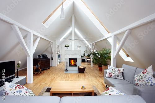 Leinwanddruck Bild large, attractive attic room with wood-burning fireplace