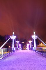 Purple illuminated bridge in Turku