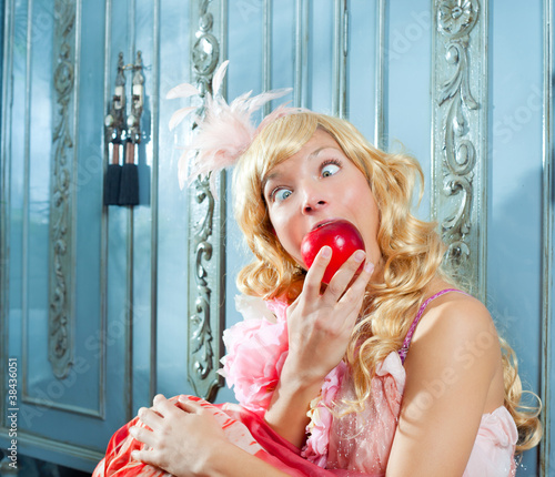 blond fashion princess eating apple funny expression