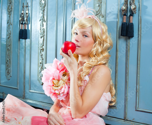 blond fashion princess eating apple with flowers dres