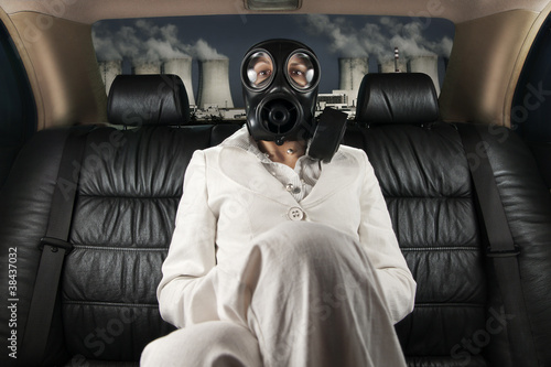 Lady in a gas mask on the back seat of limousine
