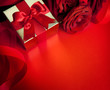 art valentines card with red roses and gift box on red backgroun