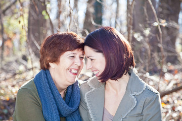Portrait of Laughing Adult Mother and Daughter