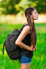 profile attractive woman glasses with backpack,