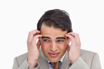 Close up of salesman having a headache