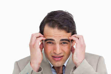 Close up of salesman experiencing a headache