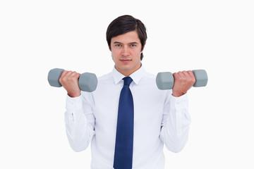 Tradesman lifting weights