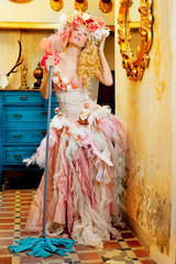 baroque fashion blonde housewife woman mop chores