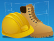 Hard hat with work boots and blueprints