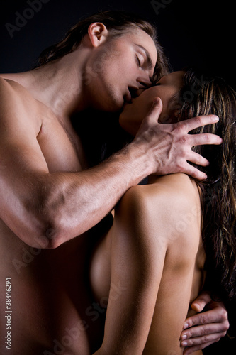 young man passionately engaged in sex with young brunette