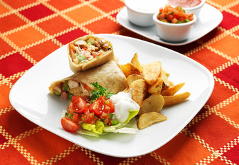 Taquitos Tortilla with chicken meat, potatoes and vegetables