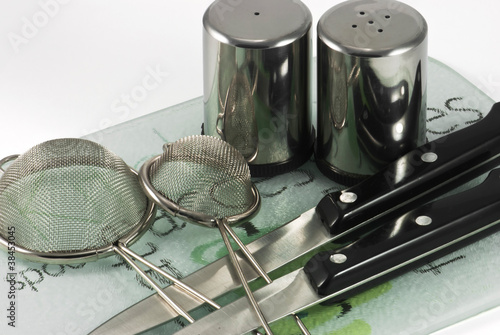 Utensils on ceramic tiles