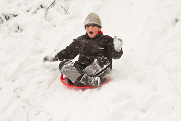 boy on sledges
