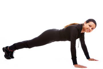 Young woman doing fitness exercises