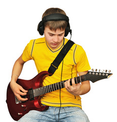 A teenager with an electric guitar