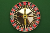 Beautiful gold roulette on a green background