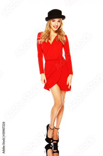 Model In Chic Red Outfit Displaying Legs