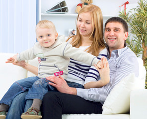 A happy family with kid on the couch