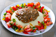 Beef goulash with potatoes and vegetables salad